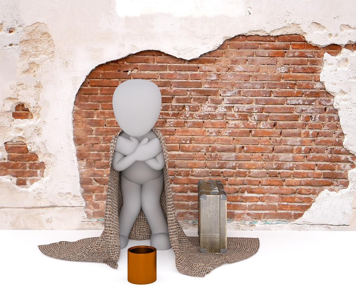 Symbolfigur steht vor einer Ziegelmauer mit Decke und Koffer